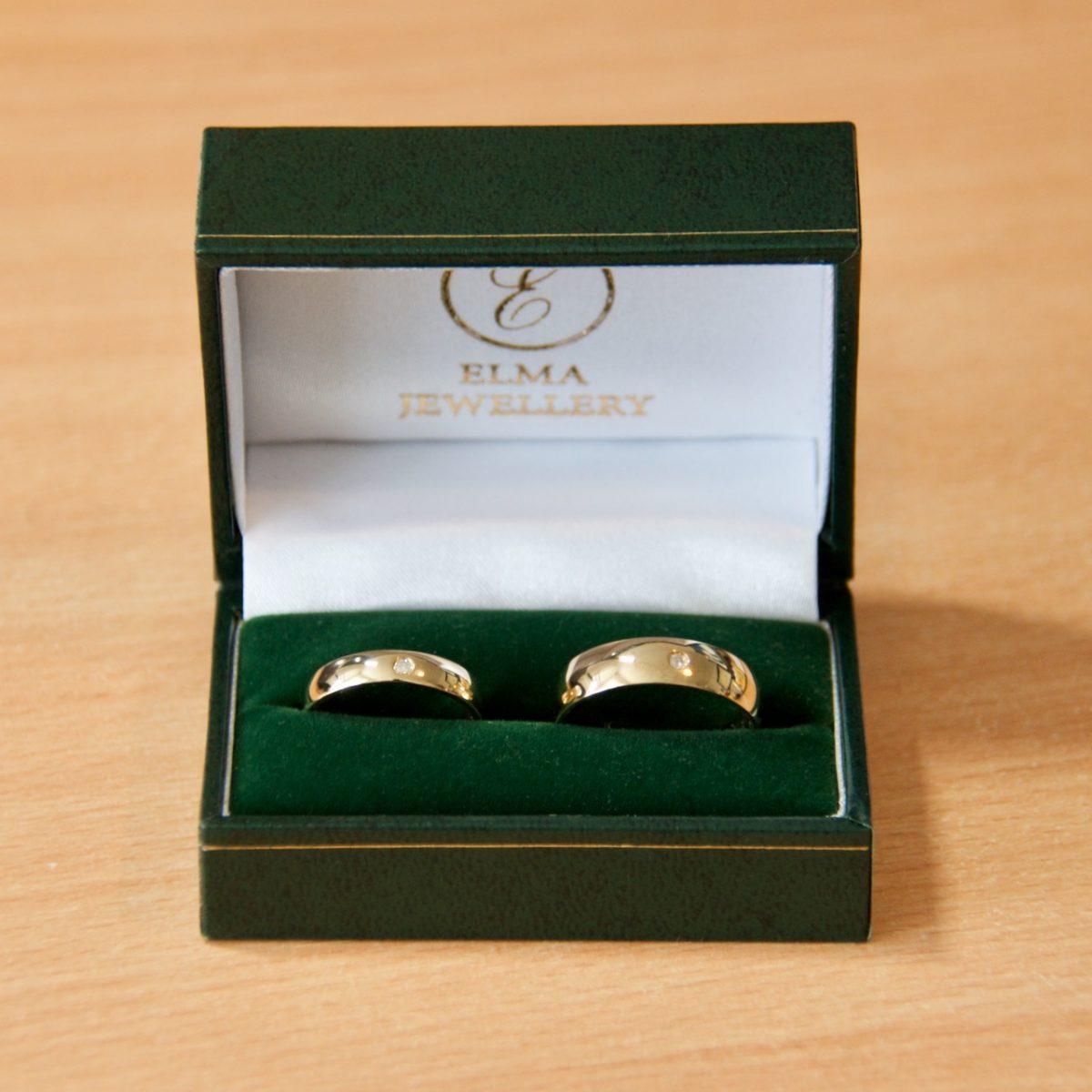 The wedding rings - 9 carat gold with 1 carat diamonds